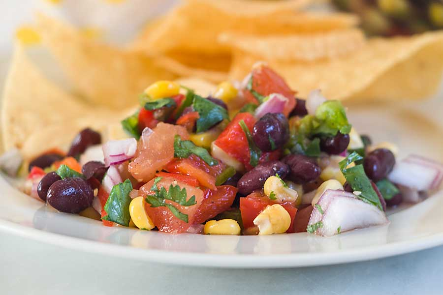 With black beans, corn, peppers and cilantro, this Black Bean and Corn Salsa is colorful, tasty and nutritious. Eat a rainbow!