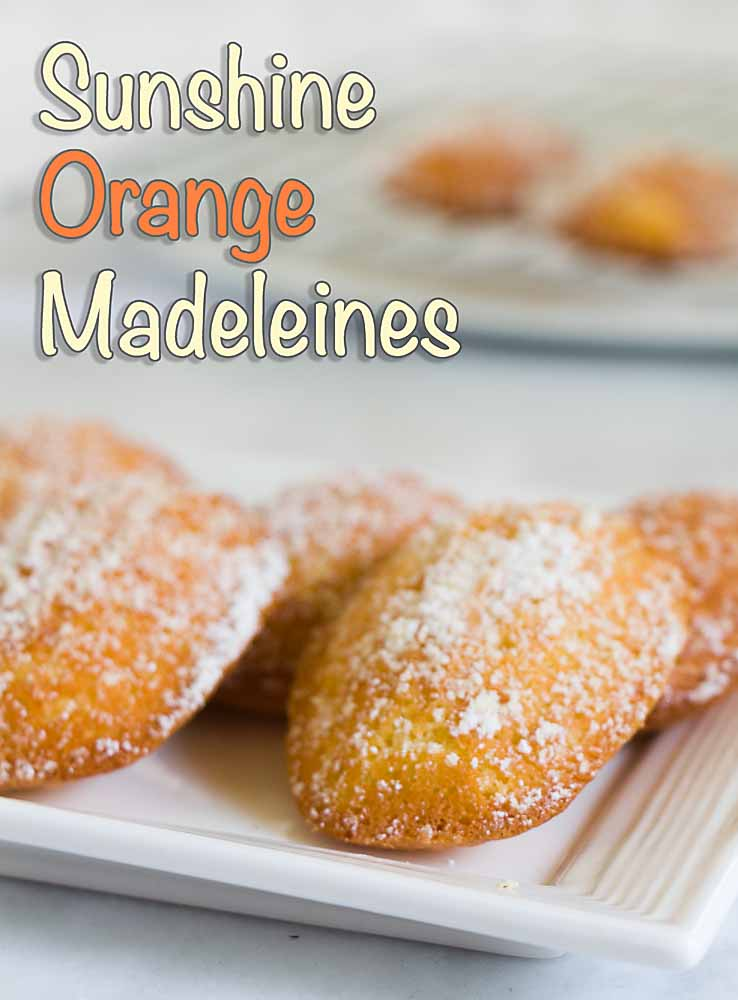 Is it a cake?  Is it a cookie?  That is the question--if you're talking madeleines.  Like these Sunshine Orange Madeleines. Sweet golden scallops, with a soft and cake-y inside and a buttery crunch outside, there's a lot to love here!