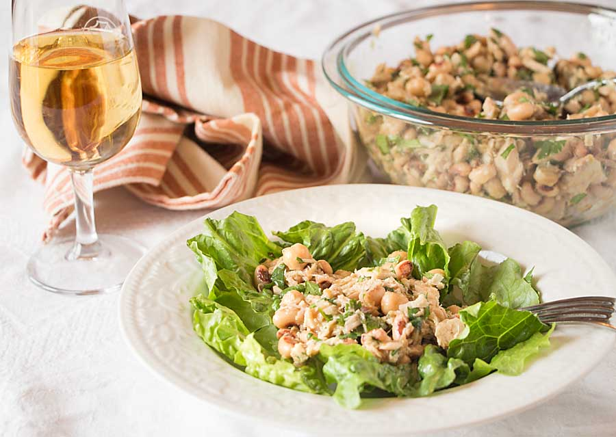 This deceptively simple Portuguese Tuna Salad, with canned tuna, beans and cilantro, topped with a flavorful vinaigrette, will surprise you with its delicious and complex flavor profile.