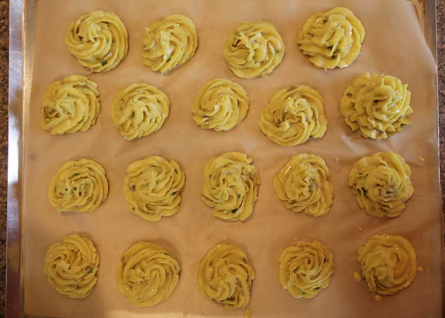 Pipe rosettes onto parchment, then bake