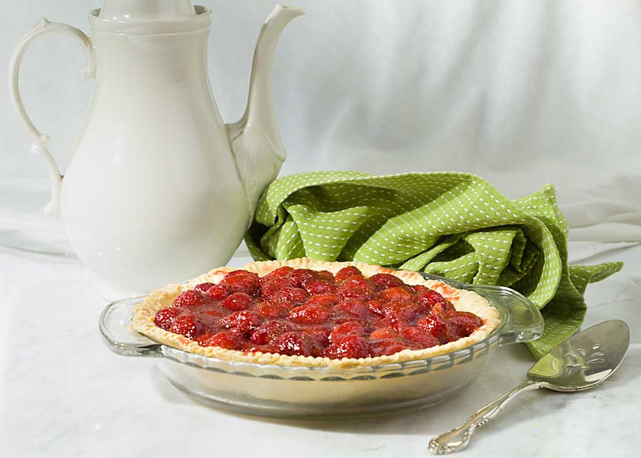 Fresh Strawberry Pie brings together the goodness of berries and the fun of pie. Ripe strawberry halves are placed in a crust then held together with thickened berry juice and topped with whipped cream. It's a perfect summer treat!