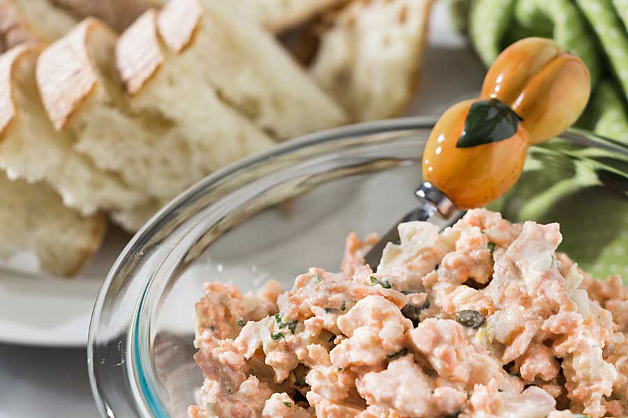 Salmon with Capers is a quick and elegant appetizer or light sandwich topper. Poach salmon and combine with a mayonnaise and caper dressing ahead of time, then serve when needed.