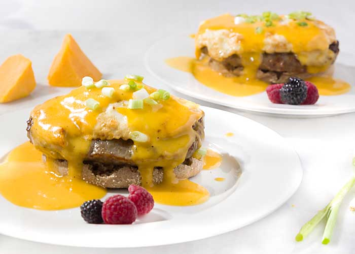 Wisconsin Eggs Benedict is a fun twist on a classic, using beer cheese sauce and brat patties. Add a Bloody Mary for the perfect Wisconsin brunch!
