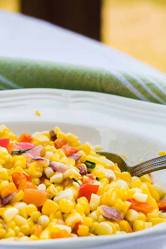 Confetti corn brings together fresh sweet corn, savory ripe peppers and flavorful herbs for a dish that is simple to make but complex in flavor.