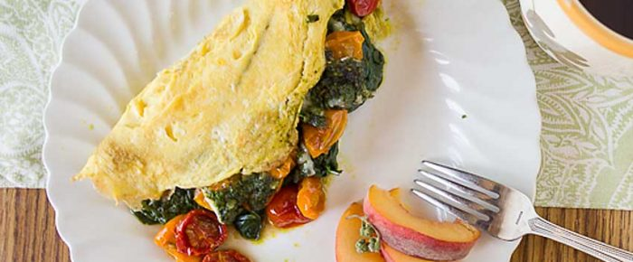 Roasted Tomato Omelet with Spinach, Pesto & Cheese