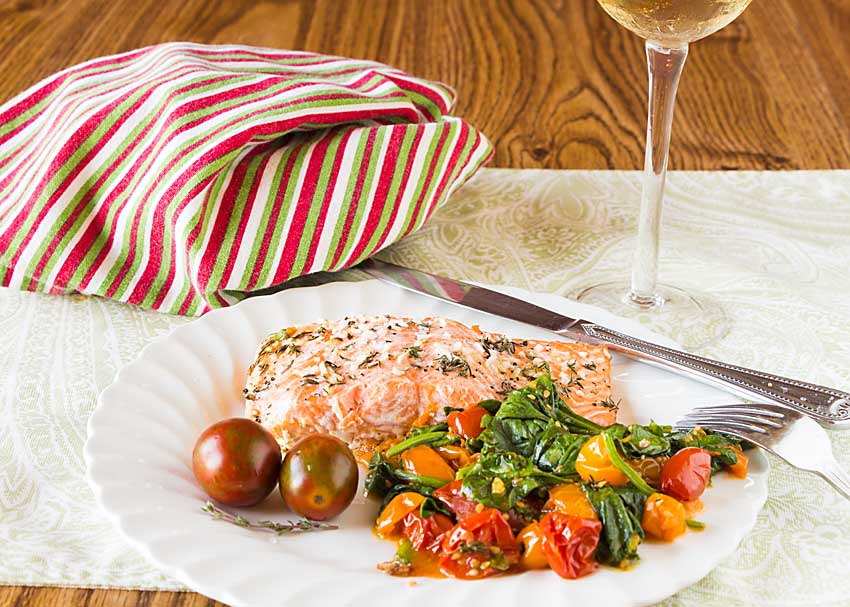 Easy to make, in a single pan, Sheet Pan Salmon with Roasted Tomatoes and Spinach serves up the best of fall. Just add bread for a complete meal.