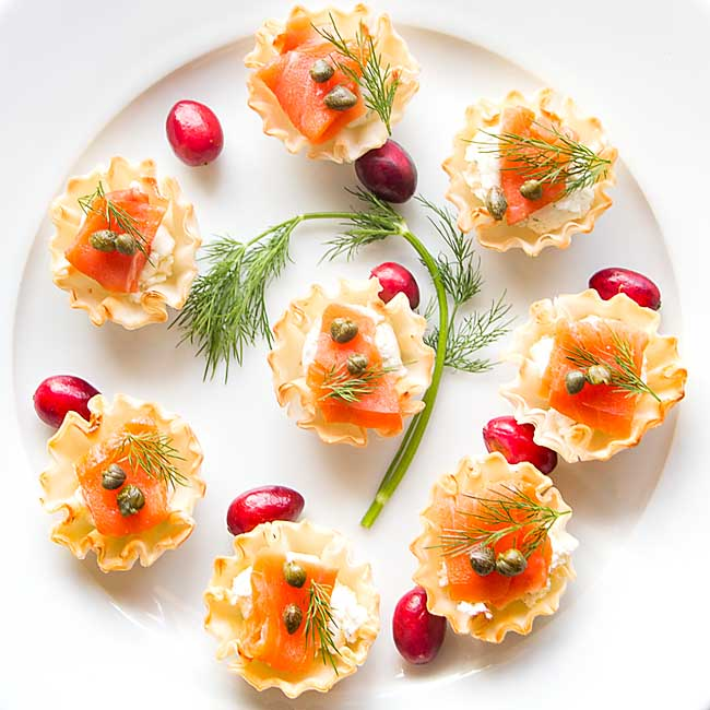 Yes you can serve these super easy and elegant Salmon Phyllo Cups on compostable plates!  Have yourself a greener holiday party today!