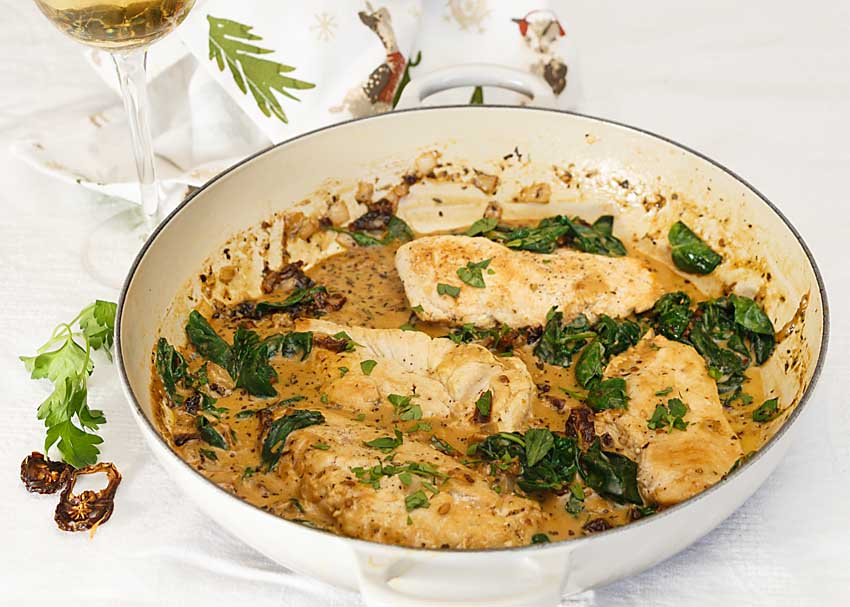 With a creamy sauce flavored with dried tomatoes & Italian herbs plus a healthy touch of spinach, Creamy Tuscan Chicken Breast is an easy & tasty dinner.