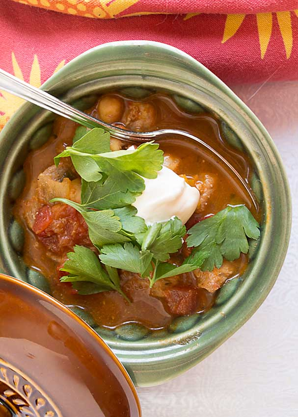 Chili Spiced Pork Stew blends flavorful spices, peppers and tomatoes with rich tender pork for a delicious dish.