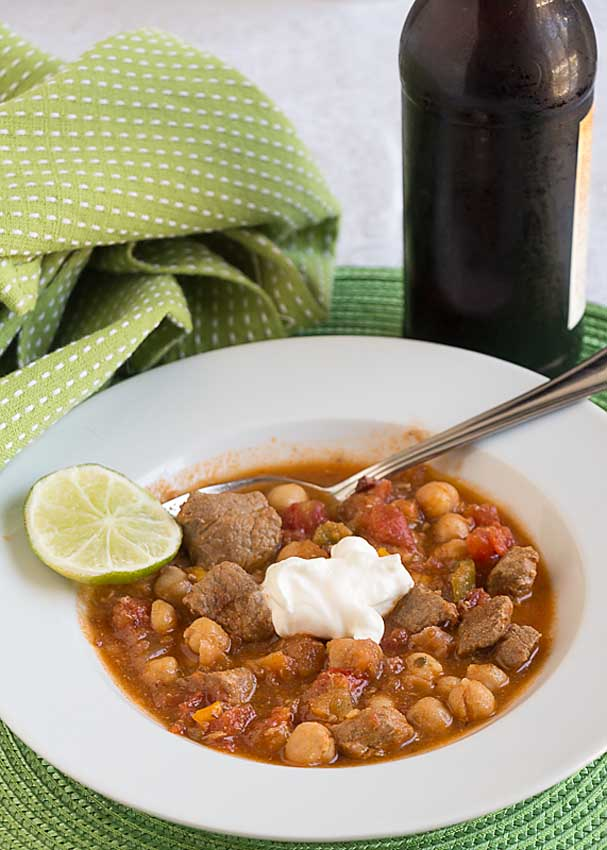 Chili Spiced Pork Stew blends flavorful spices, peppers and tomatoes with rich tender pork for a delicious dish. But is it a stew or a chili?