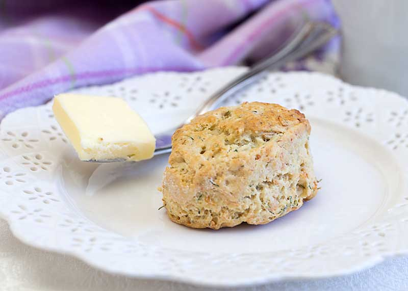 Smoked Salmon Dill Scones are a savory version of the classic breakfast treat, flavored with dill and onion and perfect for brunch or dinner.