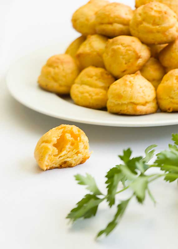 Gougères Cheese Puffs are warm, soft and creamy, like a dollop of toasty bread infused with gooey cheese.  Warm and cheesy--mmm!