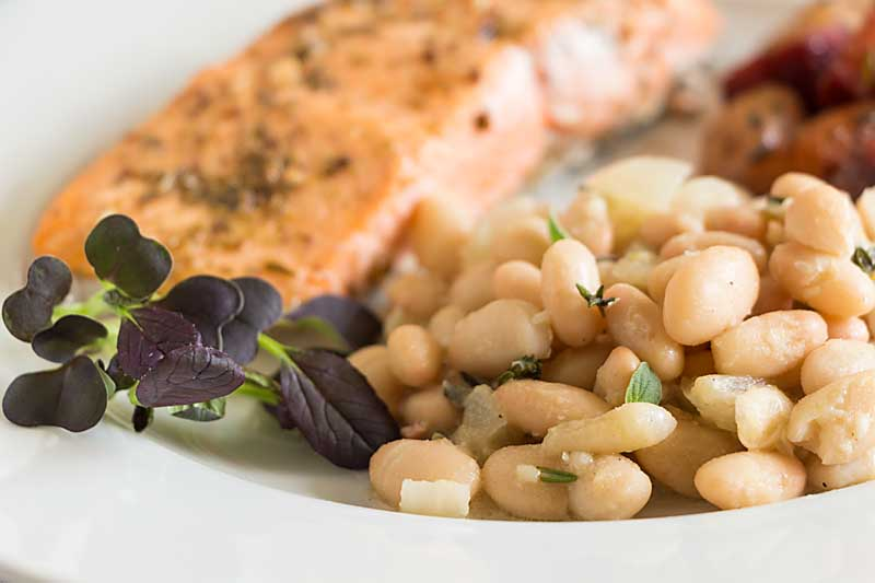 Layered onion, garlic and herb flavors blend beautifully into a rich sauce, lightened by a lemon vinaigrette to make Lemon Parmesan Herb Beans