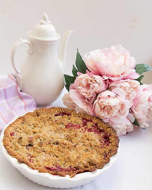 Pretty in pink with raspberries & plums, this Raspberry Plum Streusel Pie (based on Betty Crocker's French Apple Pie) is perfect for Easter or Mother's Day.