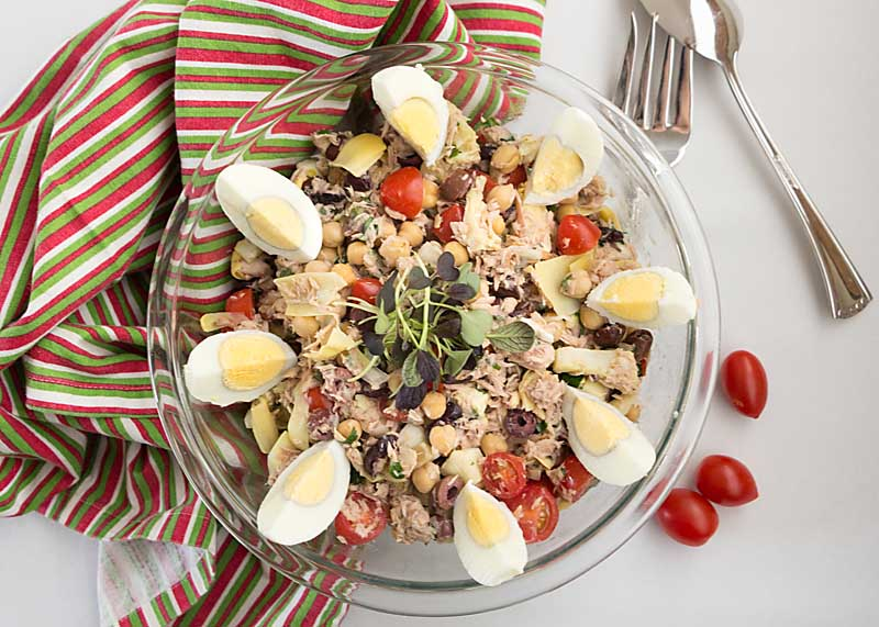 With artichokes, tuna, chickpeas, olives and grape tomatoes, this tuna antipasto salad would be perfect for a summer picnic or potluck.