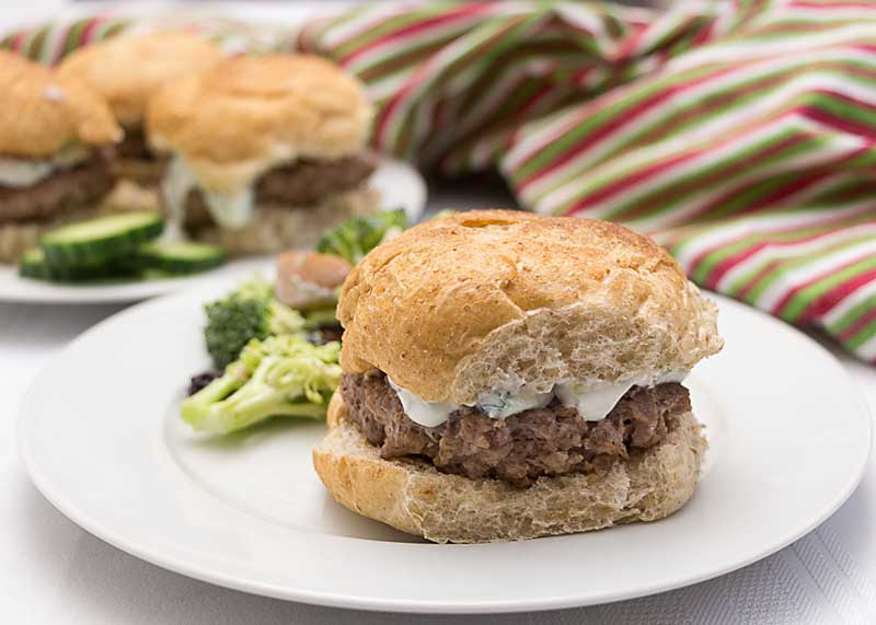 Add a little exotic flare to your summer gilling with these Lamb Burgers with Tzatziki Sauce--the cucumber, yogurt, lemon sauce is the perfect compliment!
