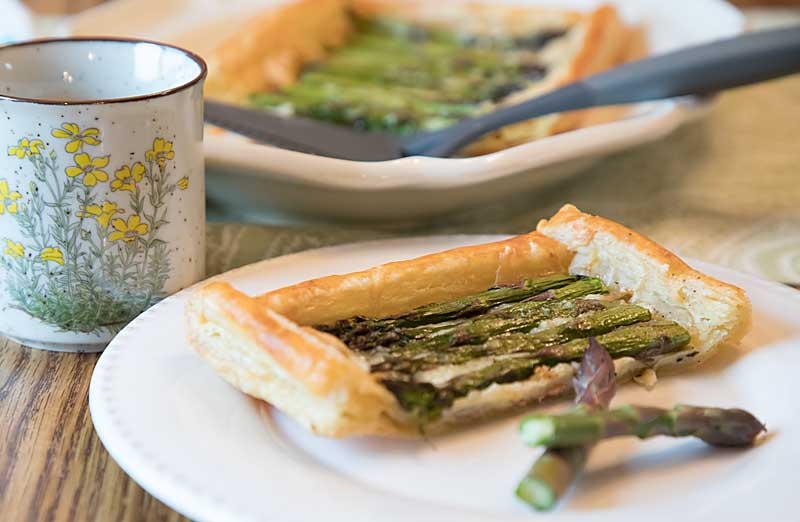 Asparagus Gruyere Tart combines nutty gruyere cheese, savory thyme and fresh asparagus in tasty puff pastry. Perfect for a light dinner or appetizer.