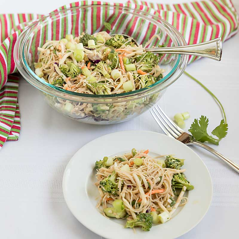 Peanut-y with a hint of spice, Thai Noodle and Vegetable Salad combines brown rice noodles, chopped vegetables and a spicy sauce.