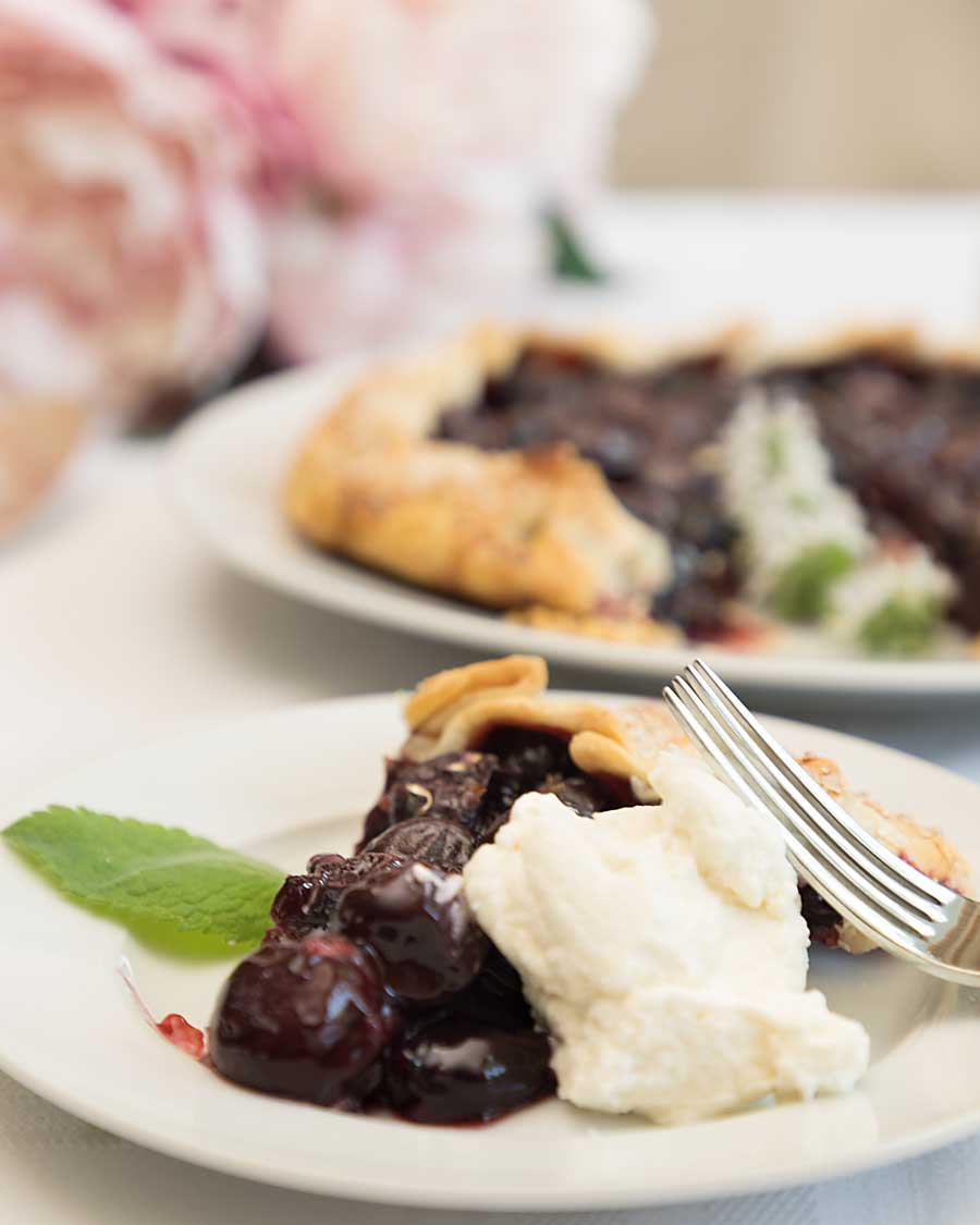 Richly fruity with a slightly sweetened crunchy crust, a sweet cherry galette may be the hit of the summer picnic season. Or breakfast. Or dessert.