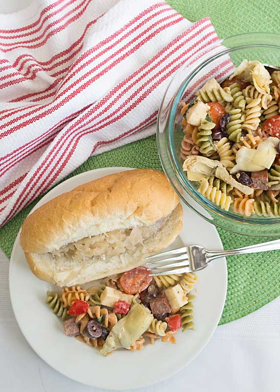 With a light creamy dressing and flavorful add-ins like salami, artichokes and red pepper, this Spicy Italian Pasta Salad is a summer go to recipe.