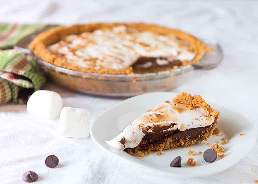 Get the fun and flavor of s'mores in a s'mores pie. With a graham crust, chocolate filling and marshmallowy meringue topping, who needs a campfire?