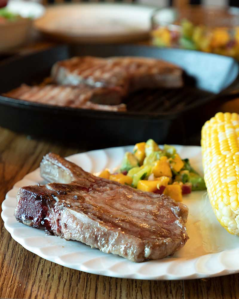 Mango Salsa & Pork Chops are a perfect complement, blending tender grilled pork with sweet, sour and spicy fresh salsa.