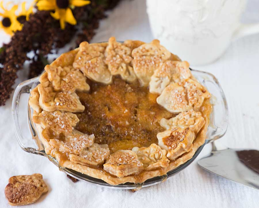 Dressed up with leaves and acorn cutouts, this peach pie is perfect to transition summer to fall. Made with less sugar even!