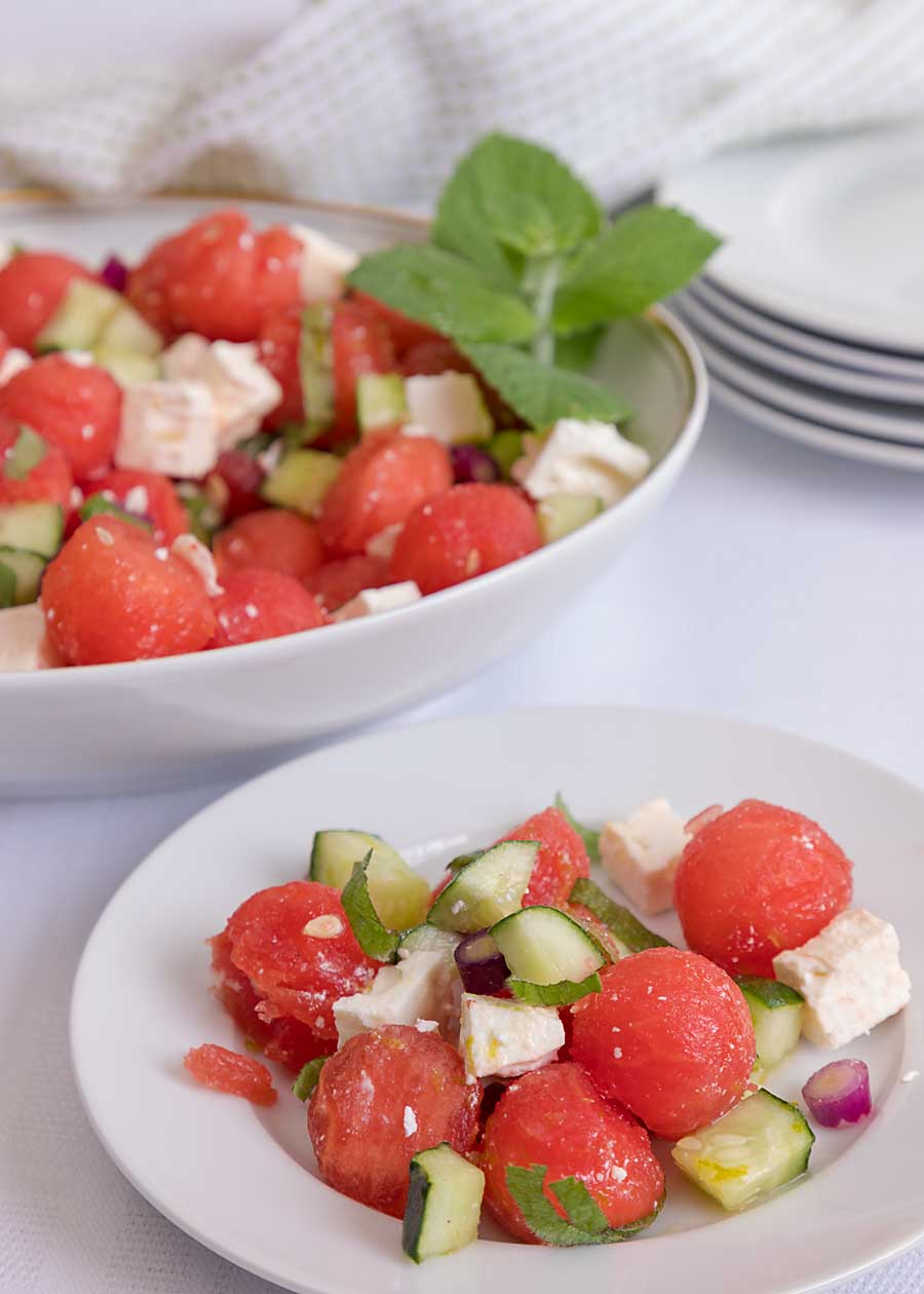Make the most of the rest of summer with this flavorful Watermelon Feta Salad, including cumber, mint and a fresh dressing.