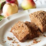 With half whole wheat flour and a modest amount of butter and sugar, this is a healthier spiced apple quick bread with a tasty streusel topping.