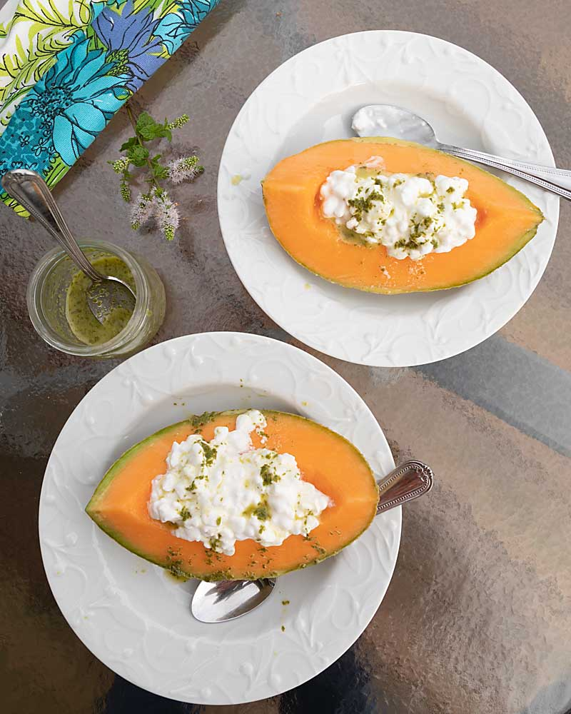 Cantaloupe with Cottage Cheese and Mint is a creamy, salty taste sensation. With the mint drizzle, it's even perfect for company brunch.