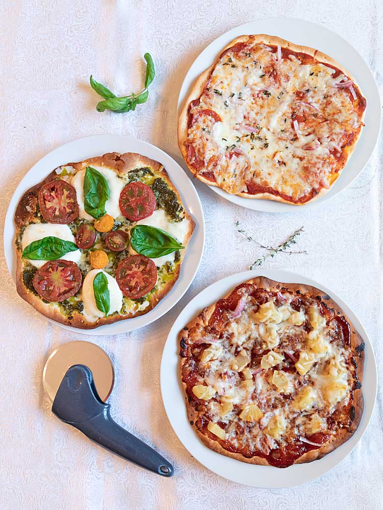 Making Pre-Baked Pizza Crust is super easy at home.  And it makes pizza night a snap, even with lots of different top-your-own pizzas.