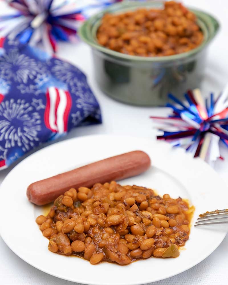 Slow cooker baked beans from scratch are easy, delicious and full of healthy ingredients right from your kitchen. Make a batch today!