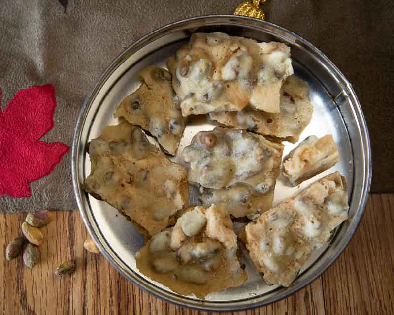 What is tastier and more fun for the holidays than Pistachio Brittle. Step by step instructions for making this candy favorite with no corn syrup.