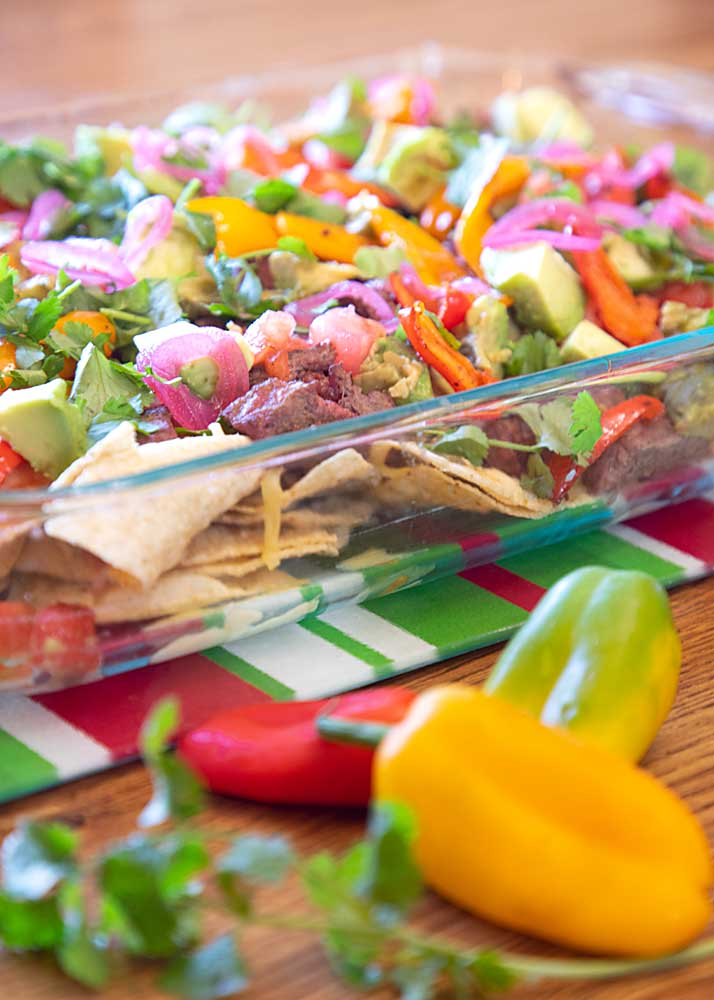 Spiff up your football snacking or just make the most fun dinner ever with these Steak Fajita Nachos.  A crowd pleaser that's ready in minutes!