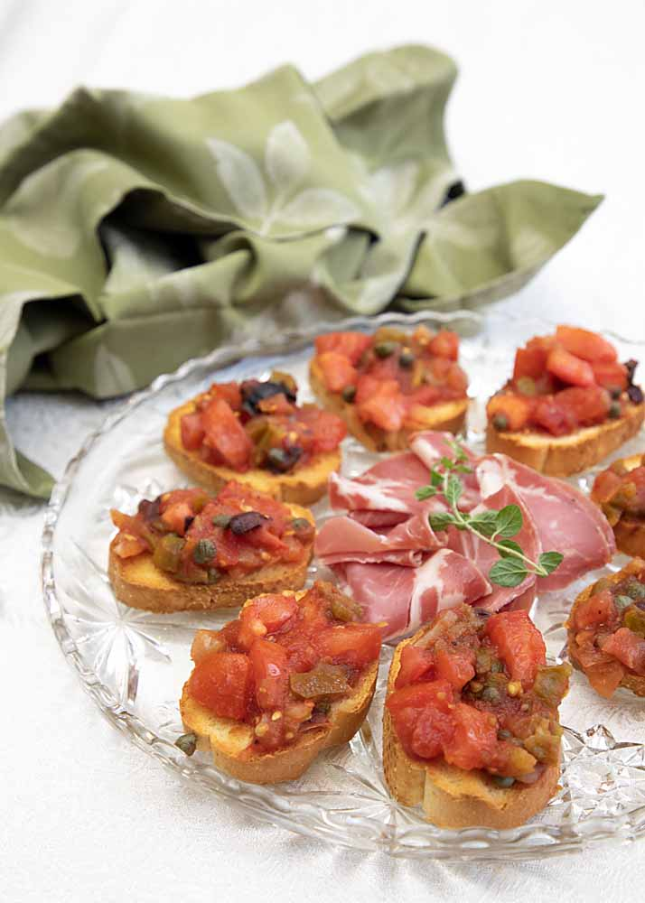 Made with jarred salsa, fresh tomato, olives and capers on French bread, Fusion Bruschetta is an easy appetizer that tastes like you chopped all day.