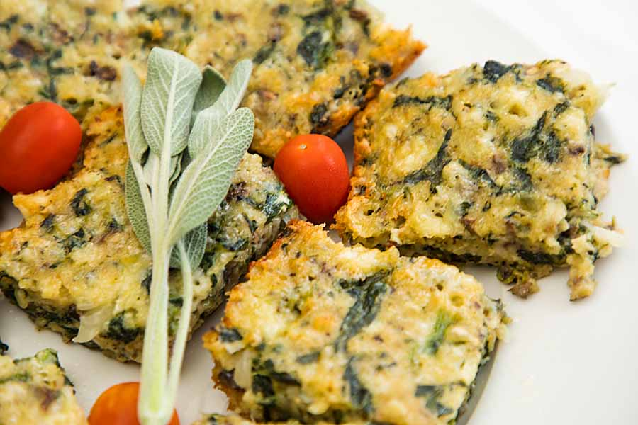 These Spinach and Cheddar Squares are like the bar cookie of savory appetizers--delicious and super easy. Just mix, pour, bake, cut, enjoy!