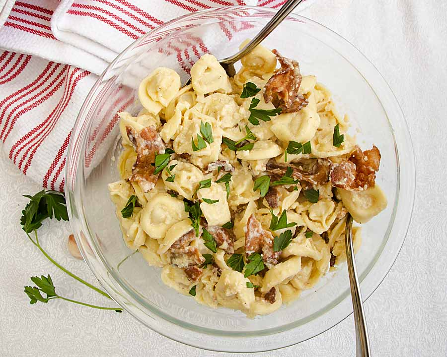 Cheese filled tortellini, covered in creamy parmesan sauce, flavored with bacon and garlic creates a classic knockoff I call Cheese Tortellini Carbonara!