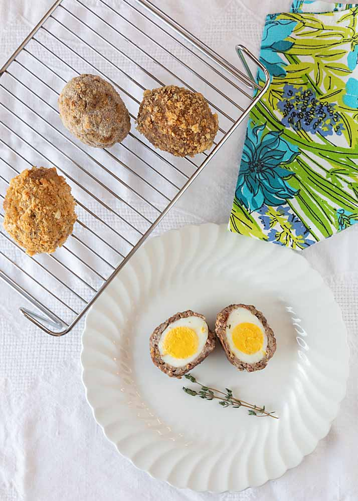 Scotch Eggs, tasty sausage-covered cooked eggs, are an appetizer that work great anywhere, from pub to picnic to poolside cocktail party.