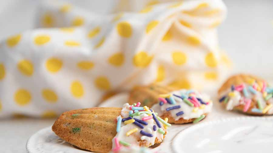 Vanilla Confetti Madeleines are a cross between cookie and cake. They are a perfect tiny treat, especially with pretty pastel sprinkles!