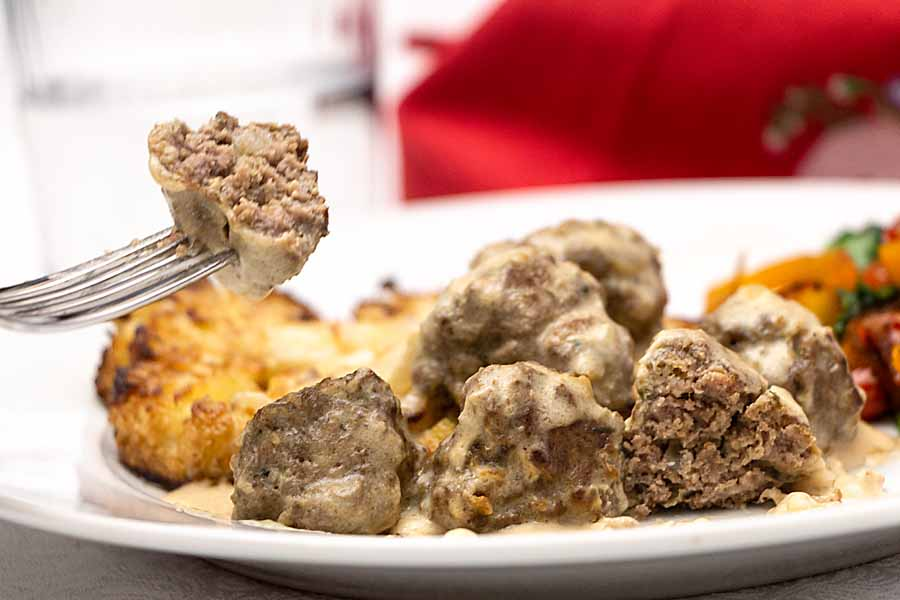 Flavorful meatballs in a creamy rich gravy, Swedish Meatballs can even be made gluten free and keto. Serve over noodles or cauliflower.
