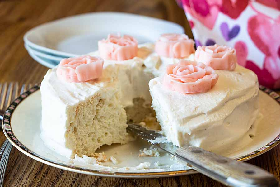 Light, airy and sweet, this low-carb angel food cake with whipped cream frosting and buttercream roses is perfect for keto or Atkins or just eating!