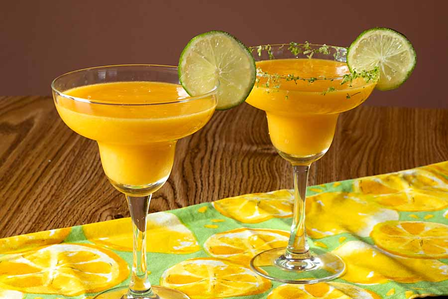 Fruity and festive with fresh mango, orange and lime, Mango Margaritas can get your summer started in the best way possible.