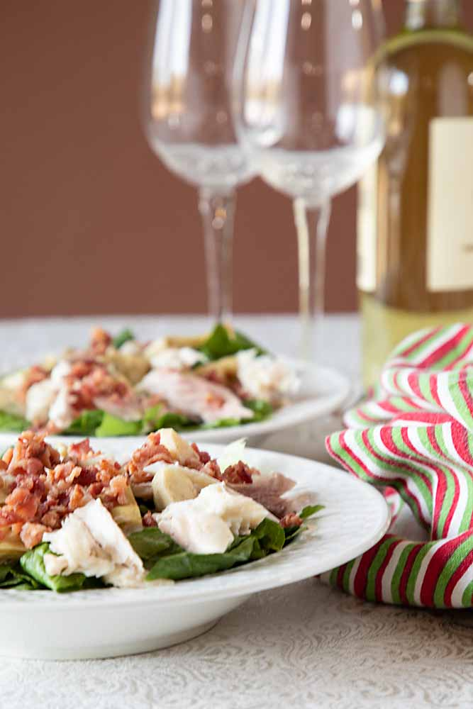 This Smoked Fish Caesar Salad brings together crisp romaine, tasty smoked fish, bacon, artichokes and creamy dressing. Perfect for an entrée or side salad.