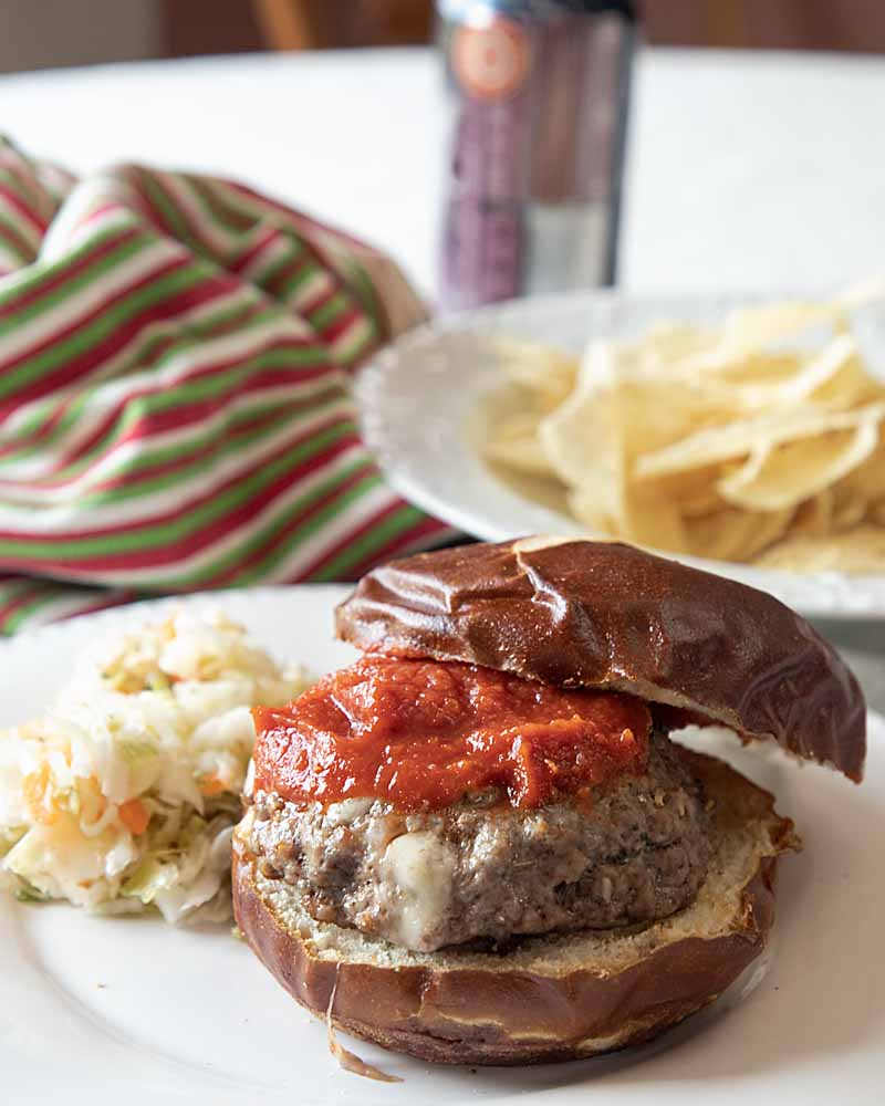 Super easy, but with a big taste punch, this Stuffed Pizza Burger is filled with tasty provolone and Italian seasonings, then topped with pizza sauce!