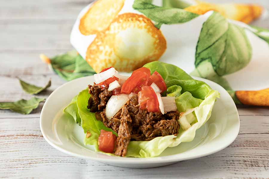 Slow Cooker or Dutch Oven Shredded Beef Barbacoa has loads of flavor & a little kick. Stuff tacos or lettuce leaves for a low-carb, gluten-free meal.