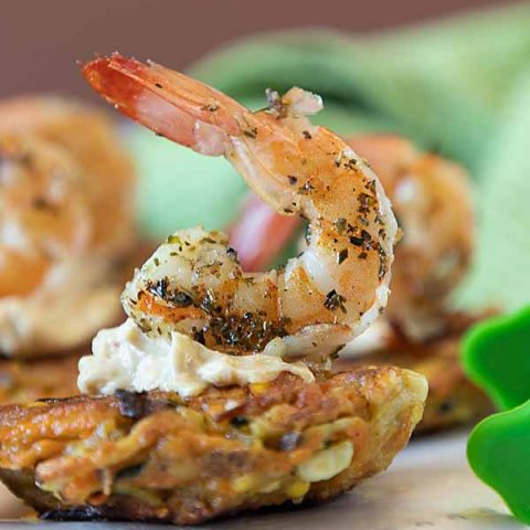Grilled shrimp & aioli on a golden vegetable fritter makes Harvest Vegetable Fritters with Shrimp a classy Farm to Table appetizer or entrée.