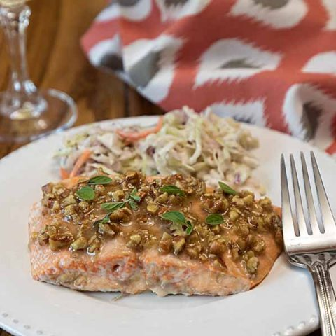 Quick and easy, this oven-roasted Honey Dijon Pecan Salmon brings together classic flavors in an entrée perfect for weekday or weekend.