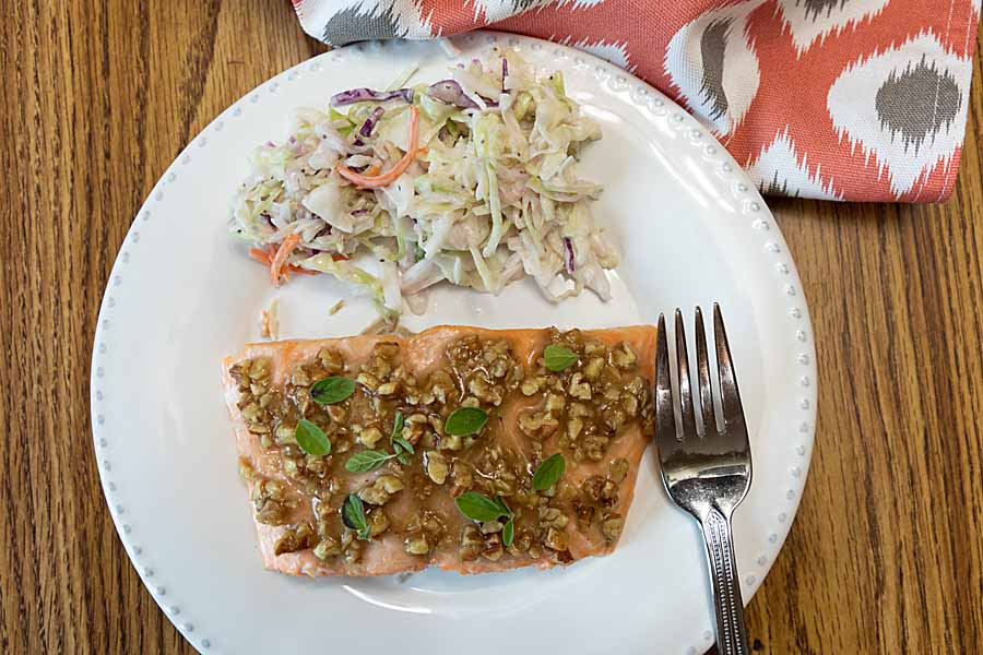Quick and easy, this oven-roasted Honey Pecan Crusted Salmon brings together classic flavors in an entrée perfect for weekday or weekend.