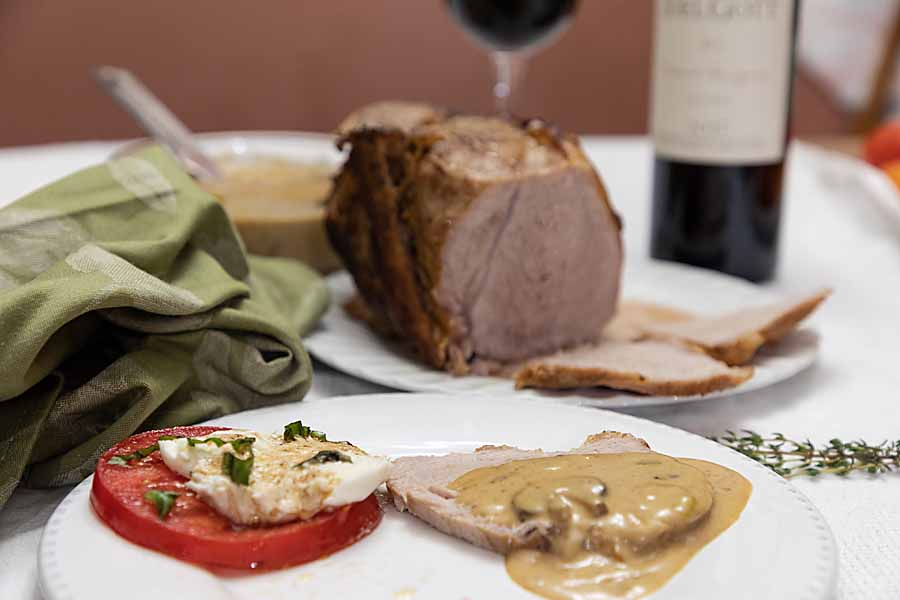 """Pork Loin with Mushroom Sauce combines flavorful meat & a rich sauce. It's like an old-fashioned """"Sunday dinner"""" entree with high end flavor."""