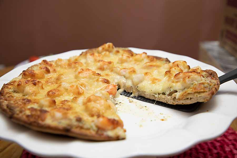 Add a little elegance to your pizza night with this easy, white seafood pizza--loaded with shrimp and scallops.